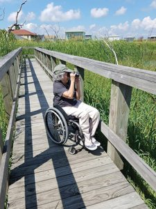 Zeiss-Birdability-appreciating_a_thoughtfully_designed_railing_on_an_accessible_trail